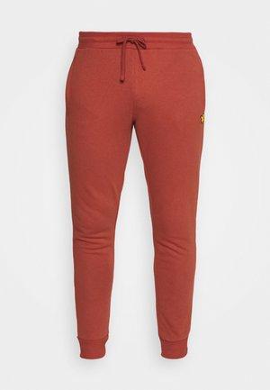 WITH CONTRAST PIPING - Pantalon de survêtement - terracotta orange