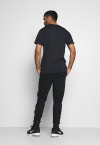 Under Armour - JOGGER - Træningsbukser - black - 2