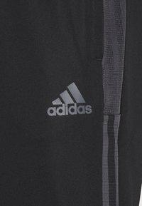 adidas Performance - TIRO  - Pantalon de survêtement - black - 4