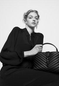 Bruuns Bazaar - LILLI MINDY DRESS - Shirt dress - black - 4