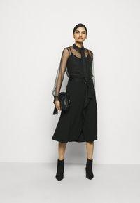 RIANI - Áčková sukně - black - 1