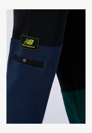 ATHLETICS - Tracksuit bottoms - nightwatch green