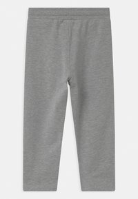 Hummel - UNO UNISEX - Tracksuit bottoms - mottled grey - 1