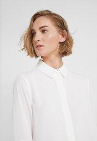 DKNY - FOUNDATION ROLL TAB THRU HIDDEN PLACKET - Button-down blouse - ivory - 3