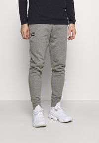 Under Armour - RIVAL - Tracksuit bottoms - pitch gray light heather - 0