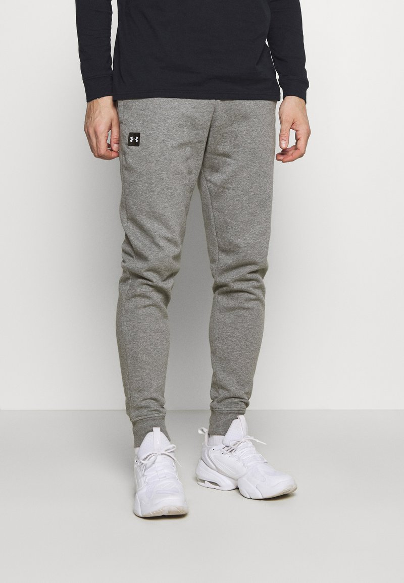 Under Armour - RIVAL - Tracksuit bottoms - pitch gray light heather