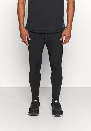 LUSANK PANTS - Trainingsbroek - black
