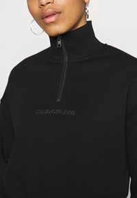Calvin Klein Jeans - BACK REFLECTIVE LOGO HALF ZIP - Sweatshirt - black - 3