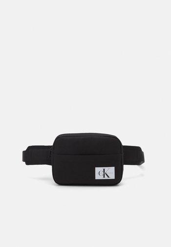 MONOGRAM BADGE WAISTBAG UNISEX - Bum bag - black