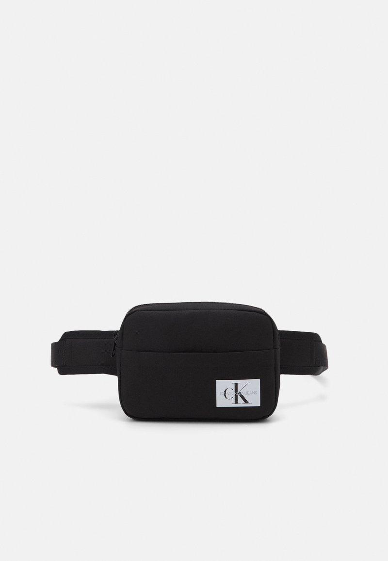 Calvin Klein Jeans - MONOGRAM BADGE WAISTBAG UNISEX - Bum bag - black