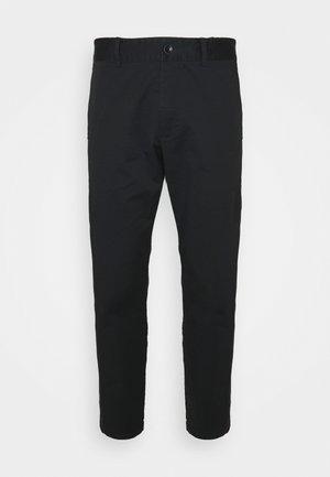 MOMENT NARROW PANT - Trousers - black