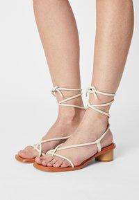 ÁNGEL ALARCÓN - T-bar sandals - nacre - 0