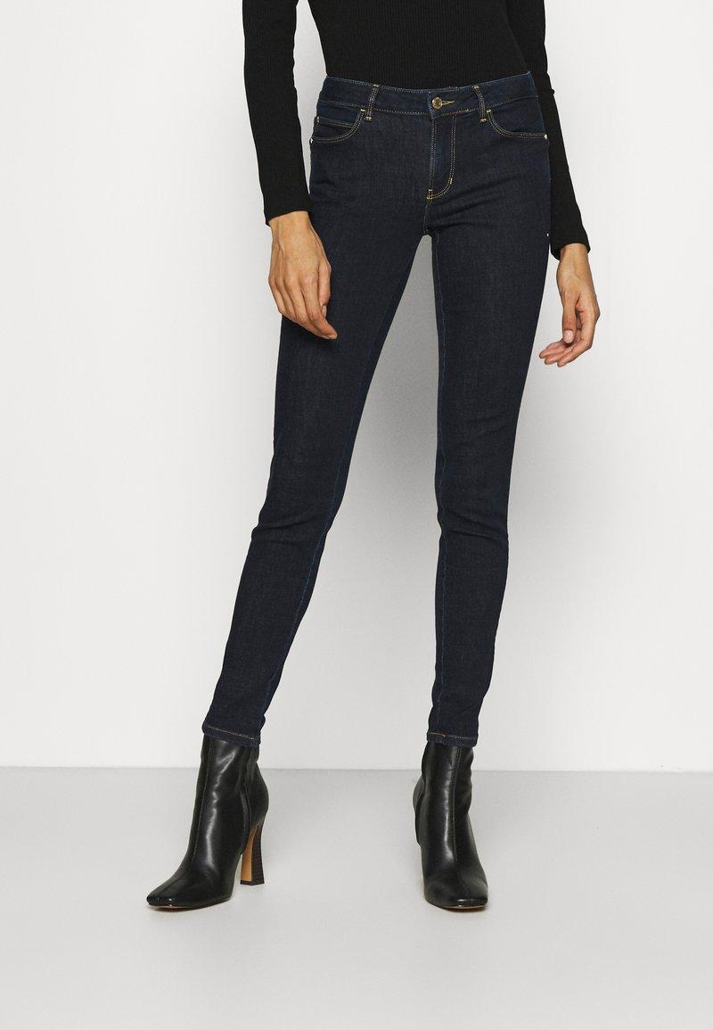 Guess - Jeans Skinny Fit - raw denim