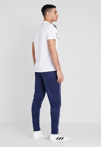 adidas Performance - CORE - Tracksuit bottoms - dark blue/white - 2