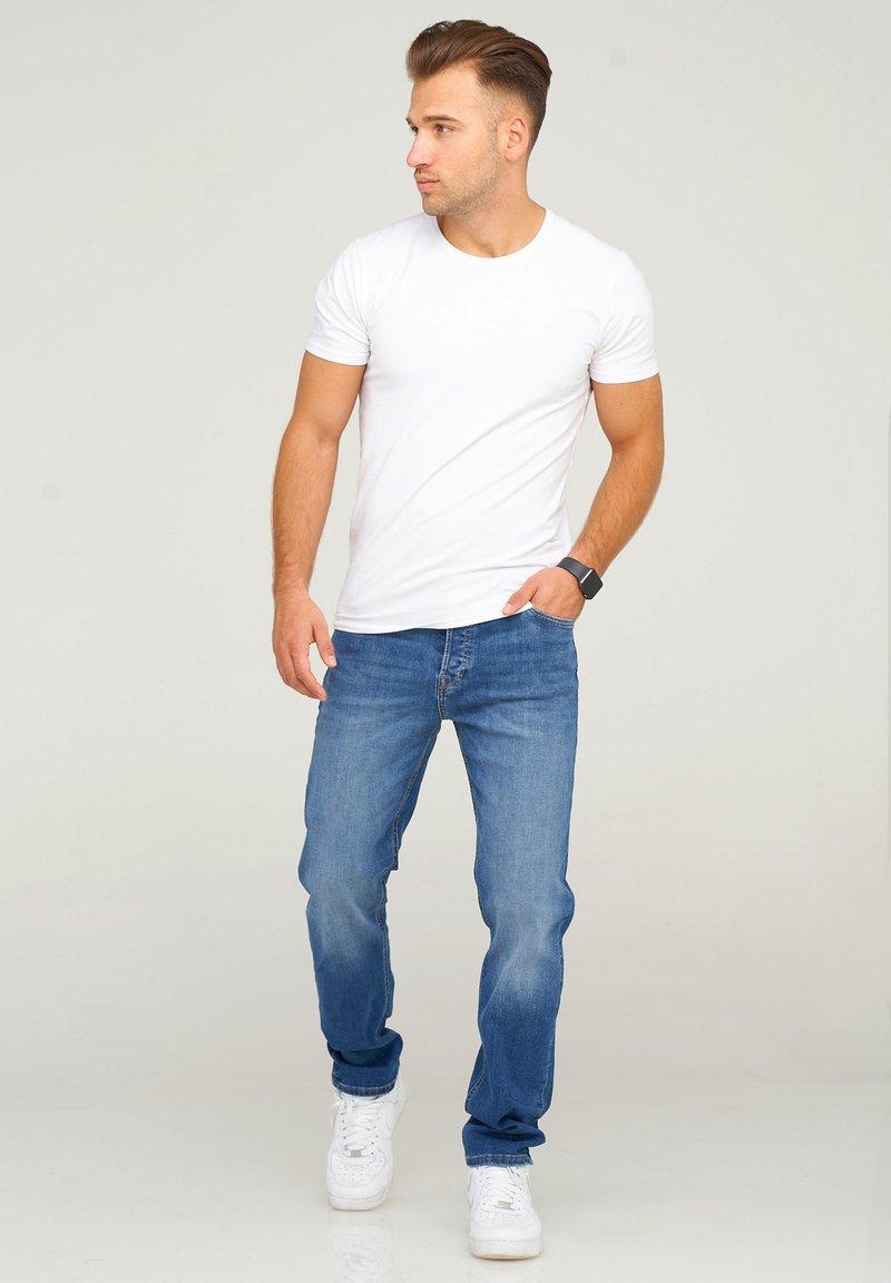 Jack & Jones - JJIMIKE JJARIS - Straight leg jeans - dark blue denim
