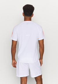 ASICS - ICON - Print T-shirt - brilliant white/flash coral - 2