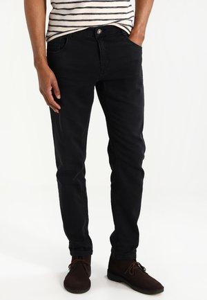 PRINCE - Straight leg jeans - black used