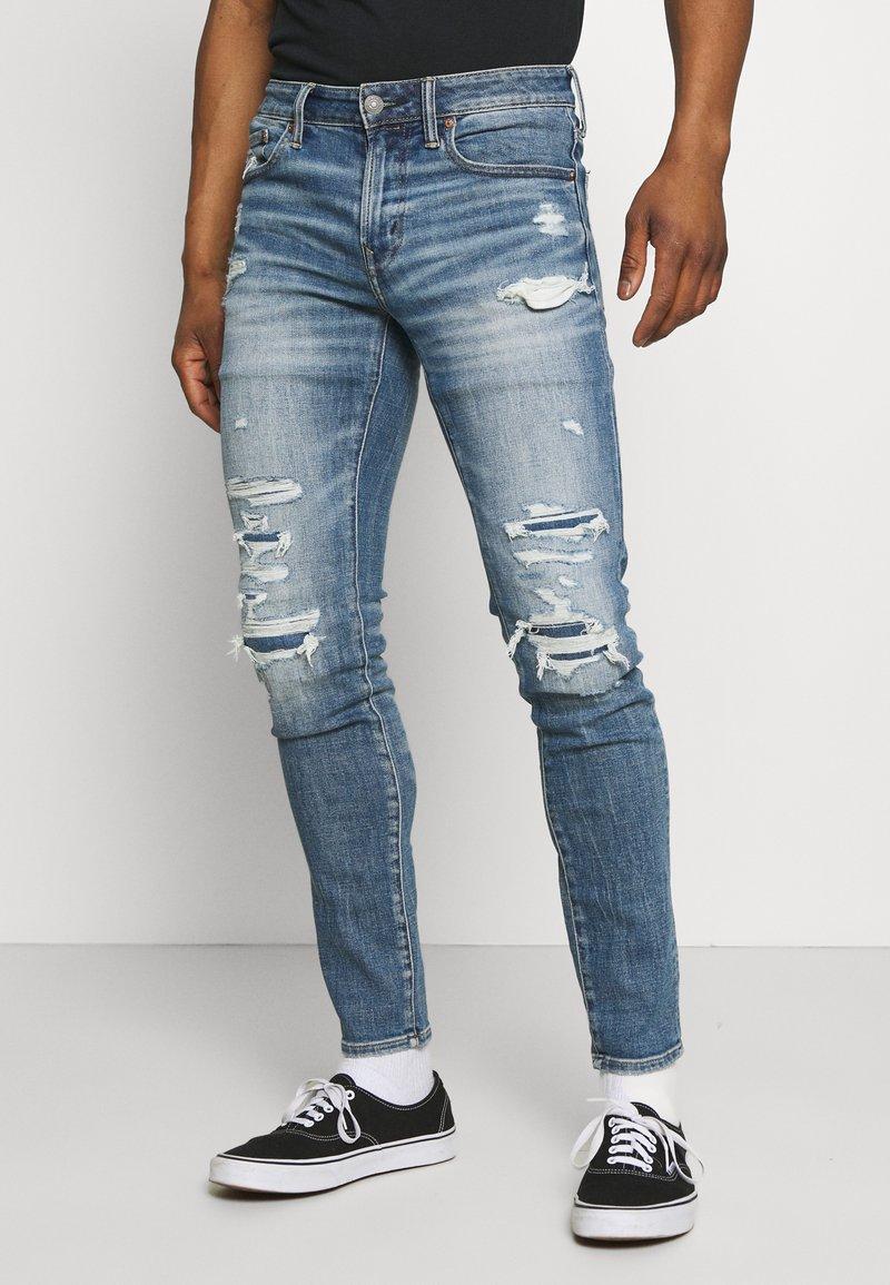 American Eagle - MEDIUM MENDED - Jeans Skinny Fit - indigo fray