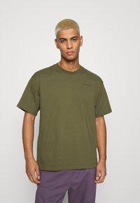 adidas Originals - BASICS UNISEX - Basic T-shirt - olive - 0
