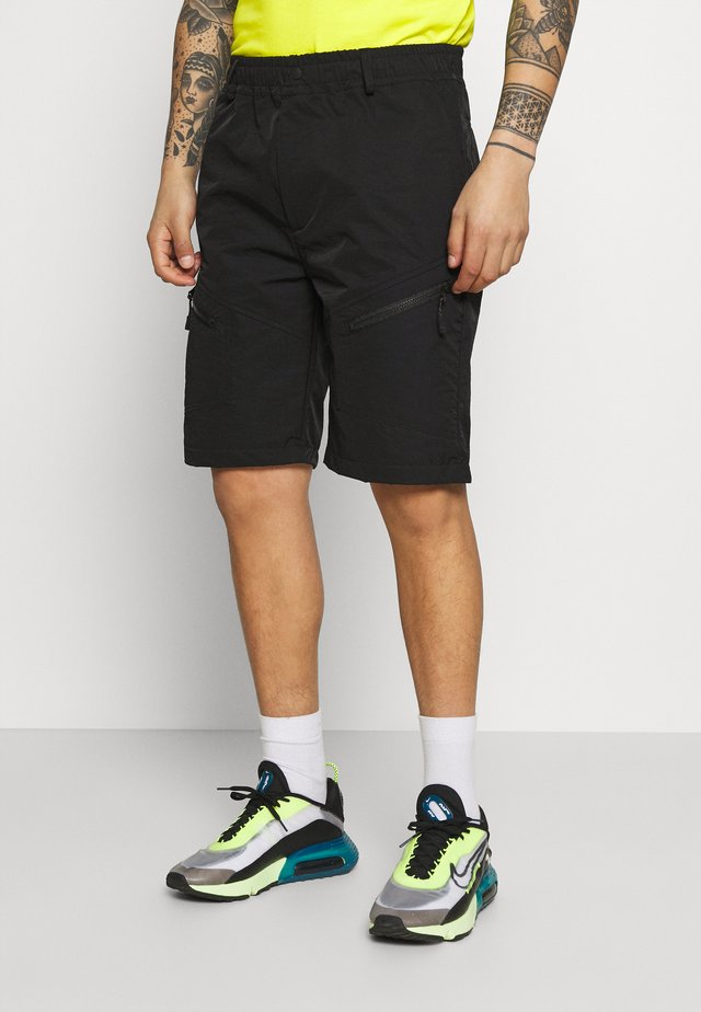 MALI TECH - Shorts - black