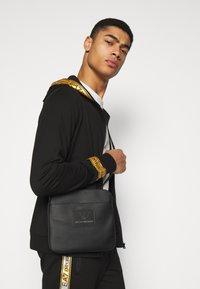 Emporio Armani - MESSENGER BAG - Across body bag - black - 0