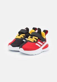 adidas Performance - FORTARUN MICKEY UNISEX - Obuwie do biegania treningowe - core black/footwear white/vivid red - 1