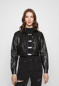 ONLY - ONLWESTA  - Faux leather jacket - black - 0