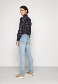 Levi's® - 519™ EXTREME SKINNY - Jeans Skinny Fit - spears adv - 3