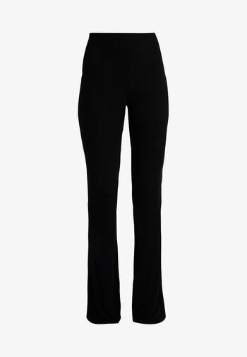 FLARE - Pantalones - black