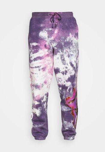 GOKU WASHED - Tracksuit bottoms - purple
