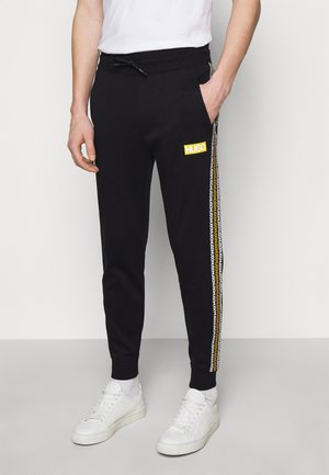 DONBURI  - Tracksuit bottoms - black