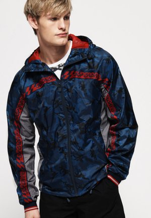 ANORAK - Waterproof jacket - royal blue/ red