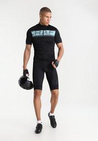 Craft - RISE SHORTS - Sports shorts - black - 1