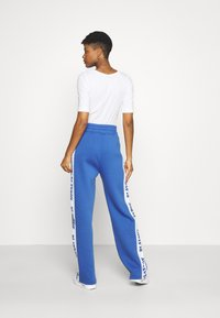Missguided - PLAYBOY SPORTS WIDE LEG - Tracksuit bottoms - navy - 2