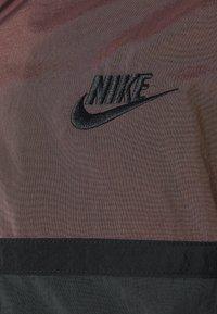 Nike Sportswear - Windbreaker - smokey mauve/dark smoke grey/black - 2
