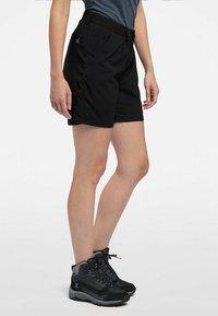 Haglöfs - MID SOLID SHORTS - Outdoor shorts - true black - 2