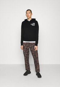 The North Face - OVERSIZE LOGO HOODIE - Mikina s kapucí - black/white - 1