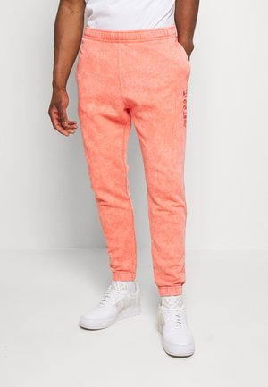 JDI PANT FT WASH - Trainingsbroek - light red