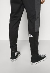 The North Face - CUFFED PANT - Träningsbyxor - black - 5