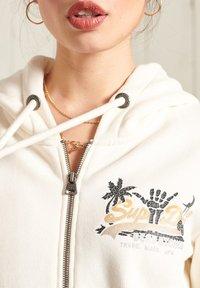 Superdry - Zip-up sweatshirt - cream - 2