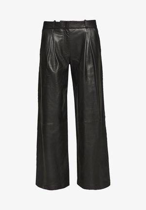 TOXIC - Kožené kalhoty - black