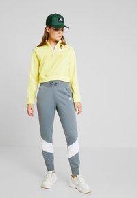 Nike Sportswear - PANT - Tracksuit bottoms - cool grey/white - 1