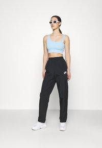 Nike Sportswear - AIR PANT - Joggebukse - black/white - 1