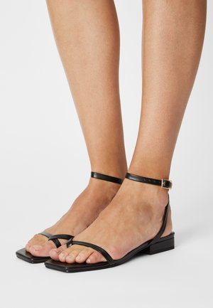 AMANI - T-bar sandals - black