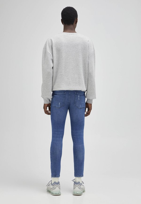 PULL&BEAR Jeansy Skinny Fit - mottled blue/niebieski melanż Odzież Męska MQKU