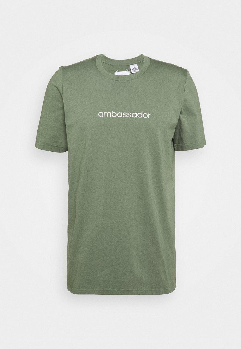 adidas Golf - CROSS - Print T-shirt - natural green