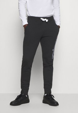 ROCHESTER - Tracksuit bottoms - black