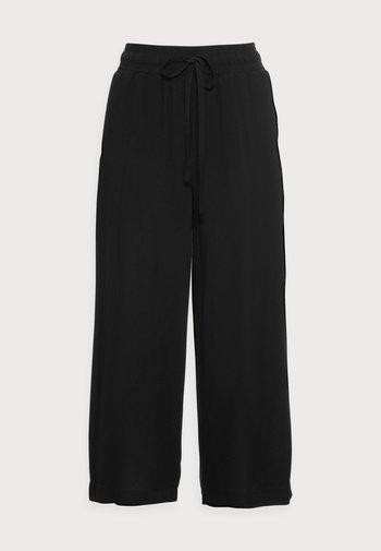 RADIA - Trousers - black