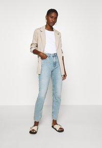 Nudie Jeans - BREEZY BRITT - Relaxed fit jeans - light desert - 1