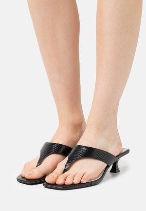 SYDNEY - T-bar sandals - black